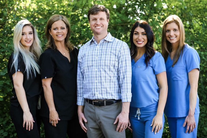 Dr. Nick Brown Dental Care Group Standing Outside 2019